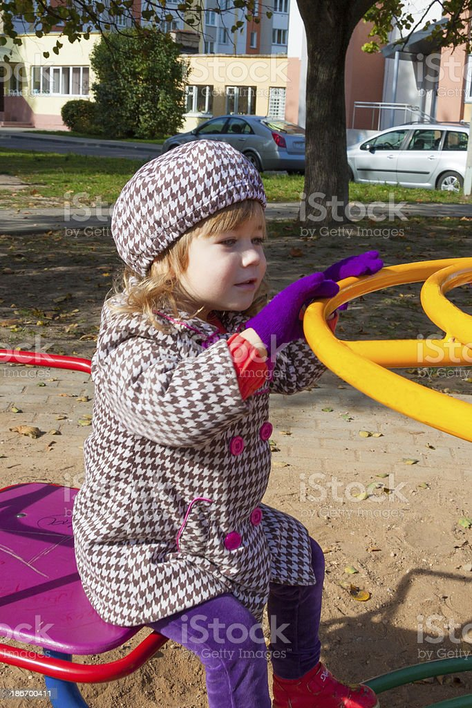 little girl on the autum playground royalty-free stock photo