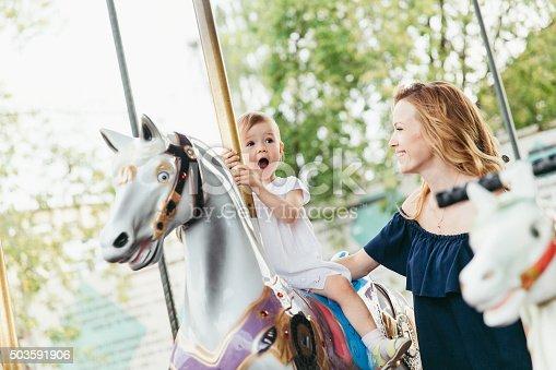 little girl on the carousel