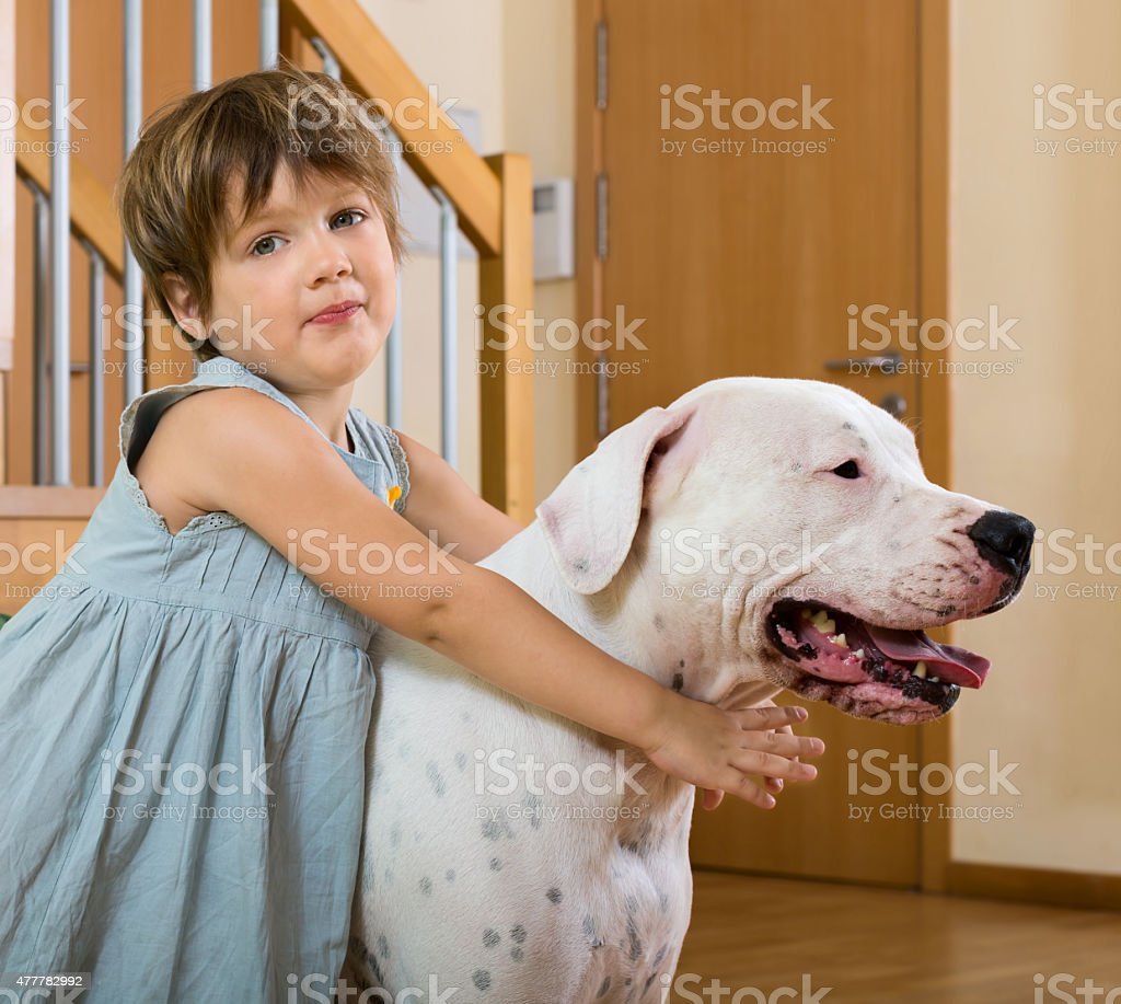little girl on the floor with dog stock photo