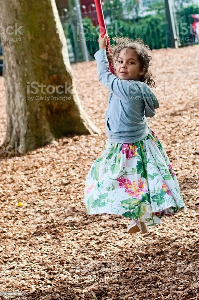 PEOPLE: Little Girl (5-6) On the Flying Fox royalty-free stock photo