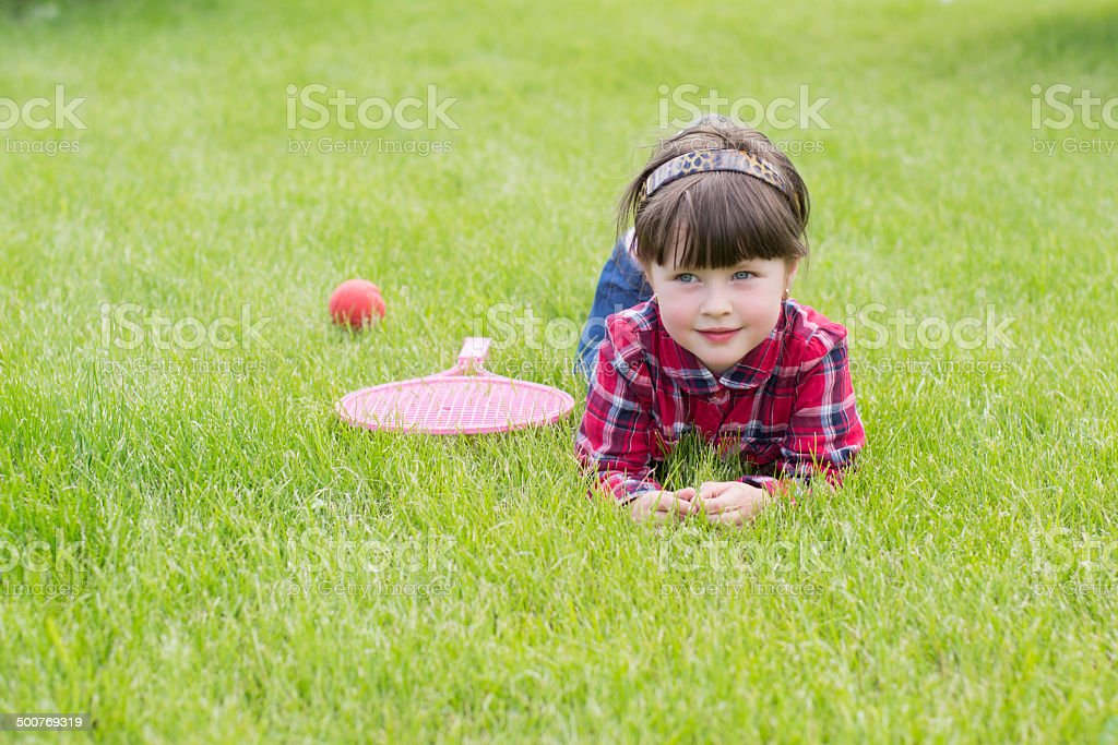 little girl on the grass royalty-free stock photo