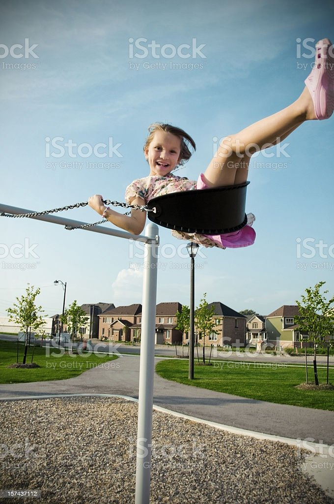 Little Girl on the Swings royalty-free stock photo