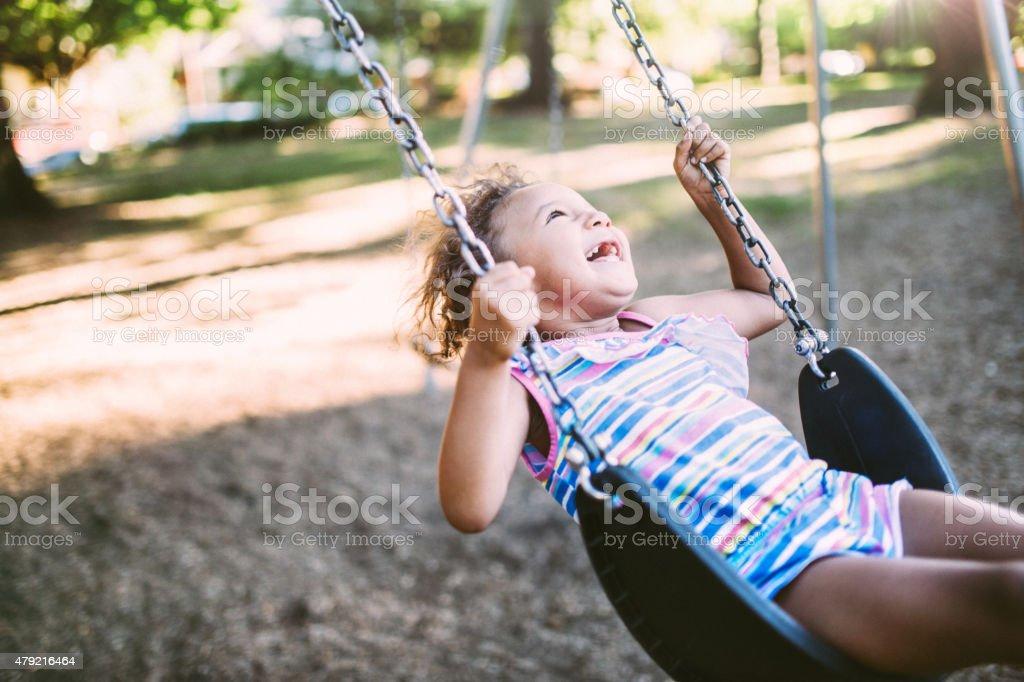Little Girl on the Swings stock photo