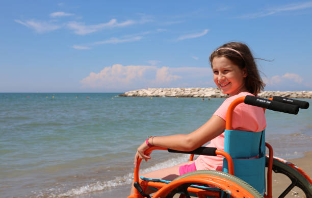 little girl on the wheelchair on summer - inpatient stock pictures, royalty-free photos & images