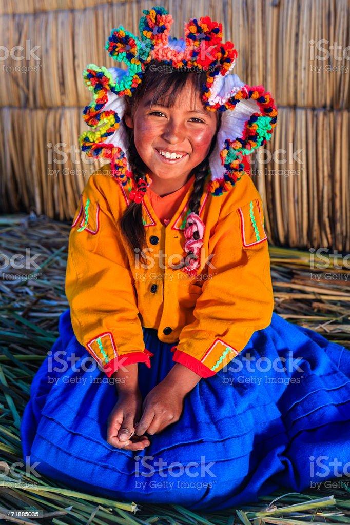 Little girl on Uros floating island, Lake Tititcaca, Peru stock photo