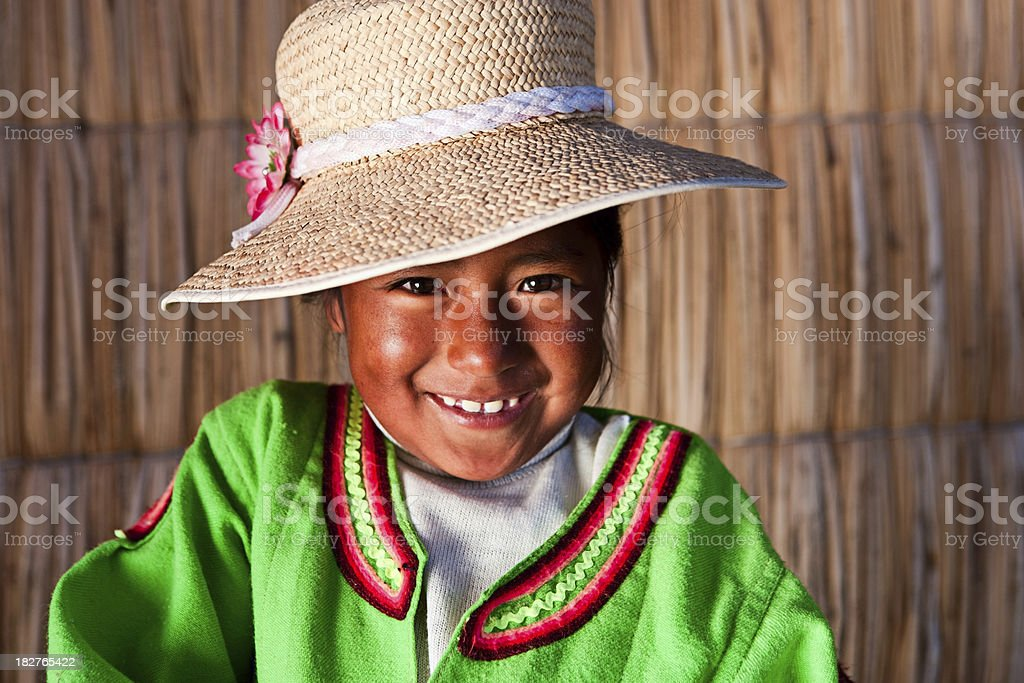Little girl on Uros floating island stock photo