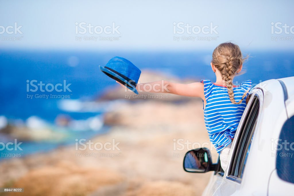 Little girl on vacation travel by car with beautiful view stock photo