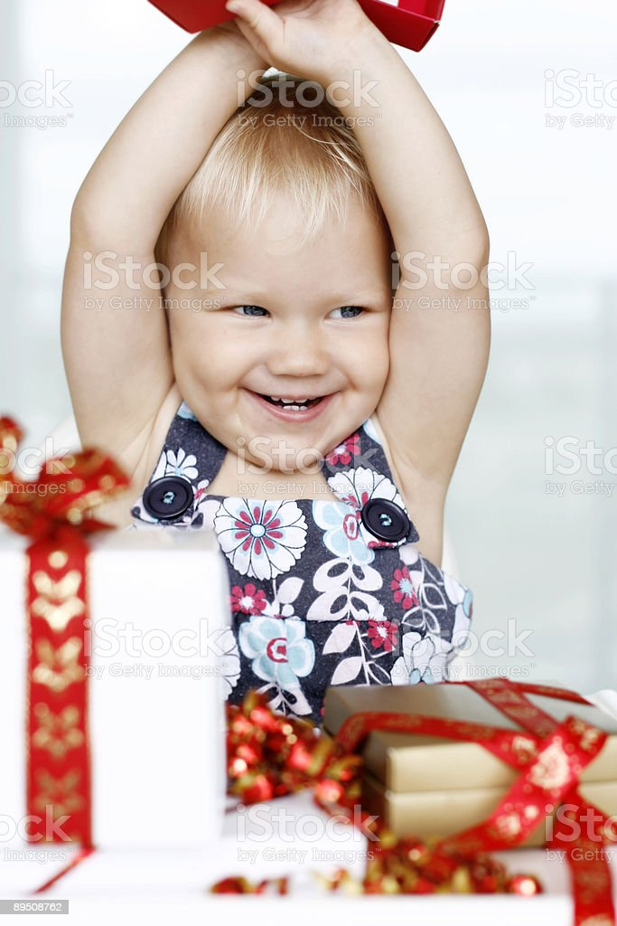 Little girl opening Christmas presents royalty-free stock photo