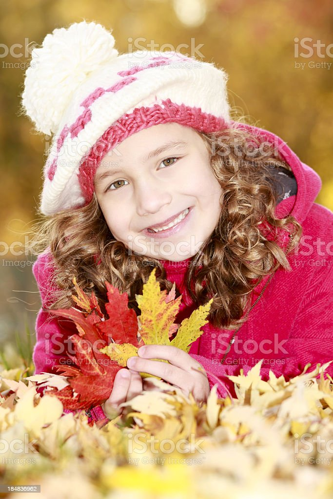 Little girl outdoors in autumn park royalty-free stock photo