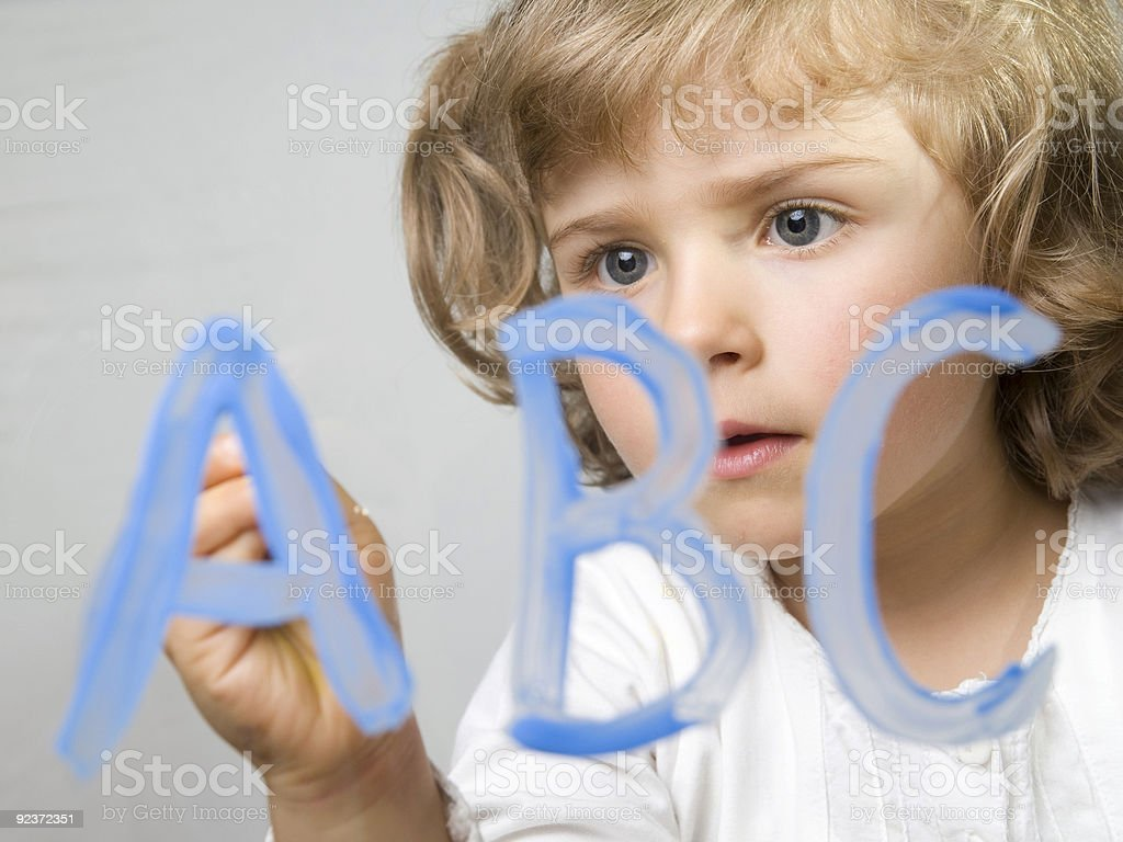 Little girl painting alphabet royalty-free stock photo