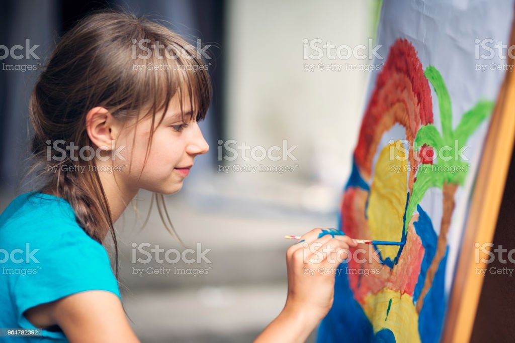 Little girl painting on easel royalty-free stock photo