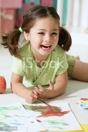 istock Little Girl Painting 157336849