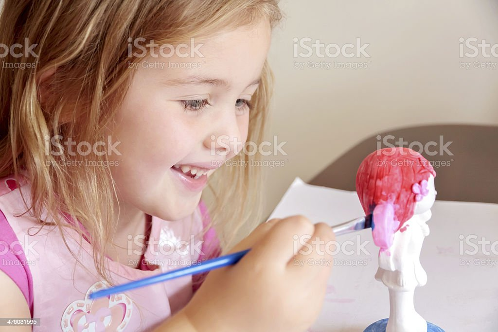 Little Girl Painting Pottery stock photo