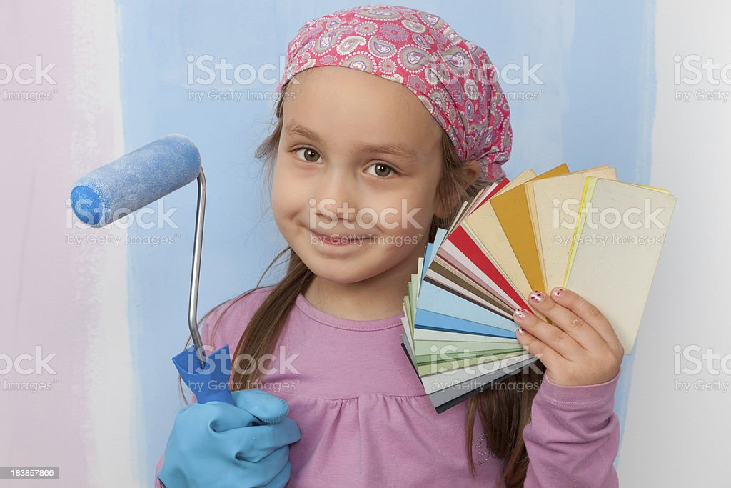 Little girl painting walls royalty-free stock photo