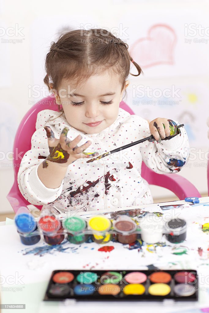 Little girl painting with watercolors. royalty-free stock photo