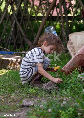 Side view of a child playing in the backyard
