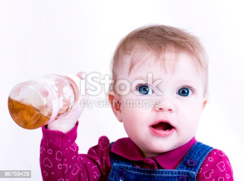 portrait of a little girl with a bottle of juice in his hand