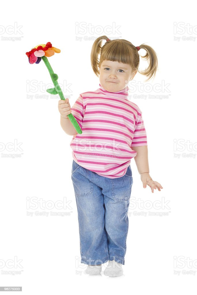 Little girl play with toy flower royalty-free stock photo