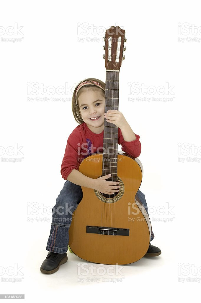 little girl playing acoustic guitar royalty-free stock photo