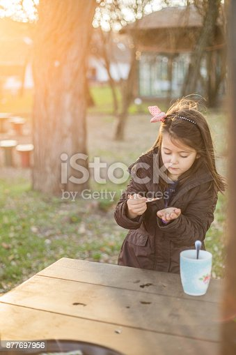 istock Little girl playing alone in nature 877697956