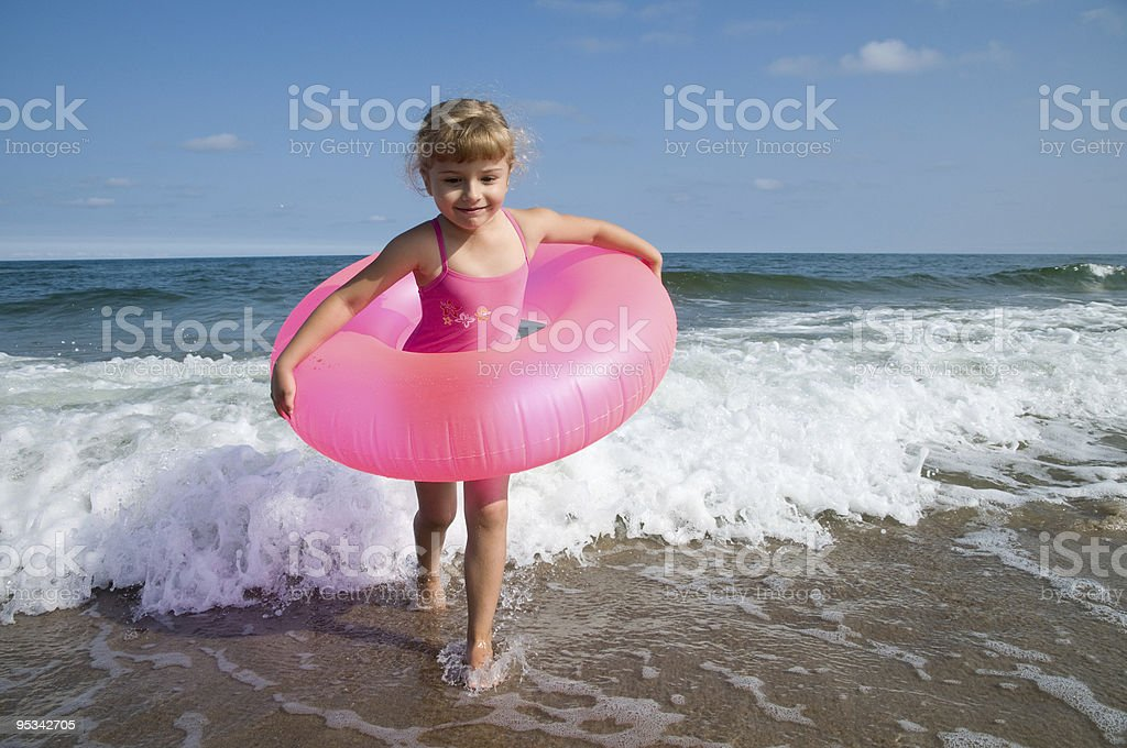 Little girl playing at the beach royalty-free stock photo