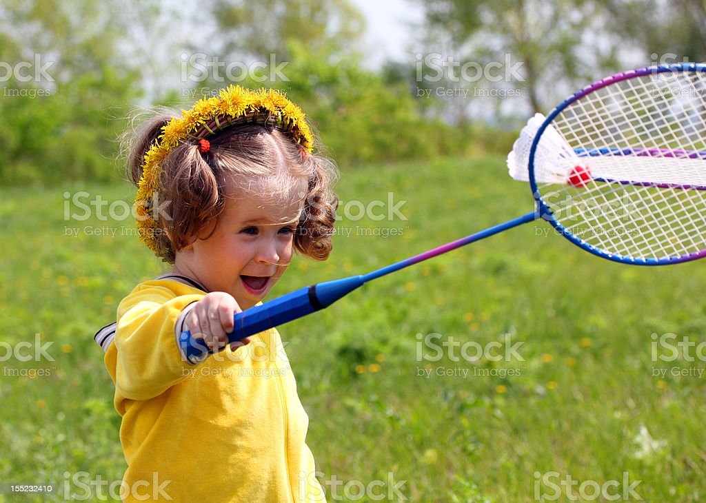little girl playing badminton royalty-free stock photo