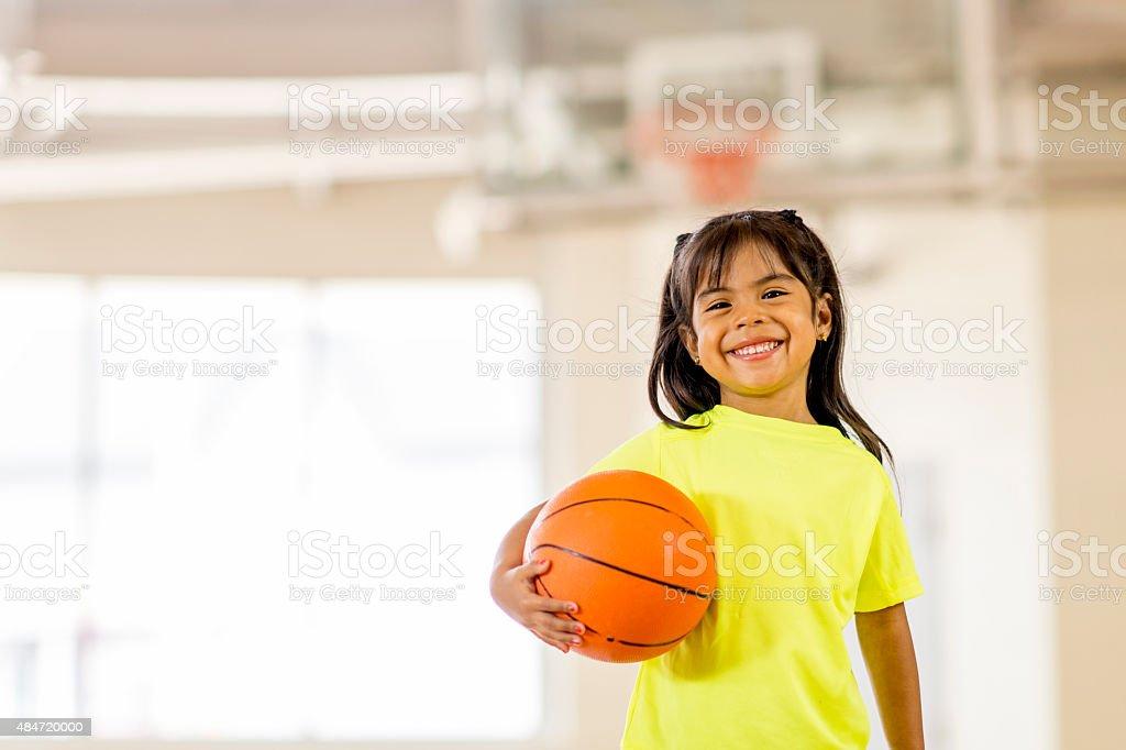 Little Girl Playing Basketball stock photo