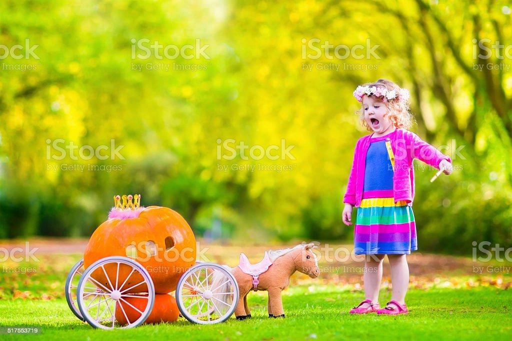 Little girl playing Cinderella stock photo