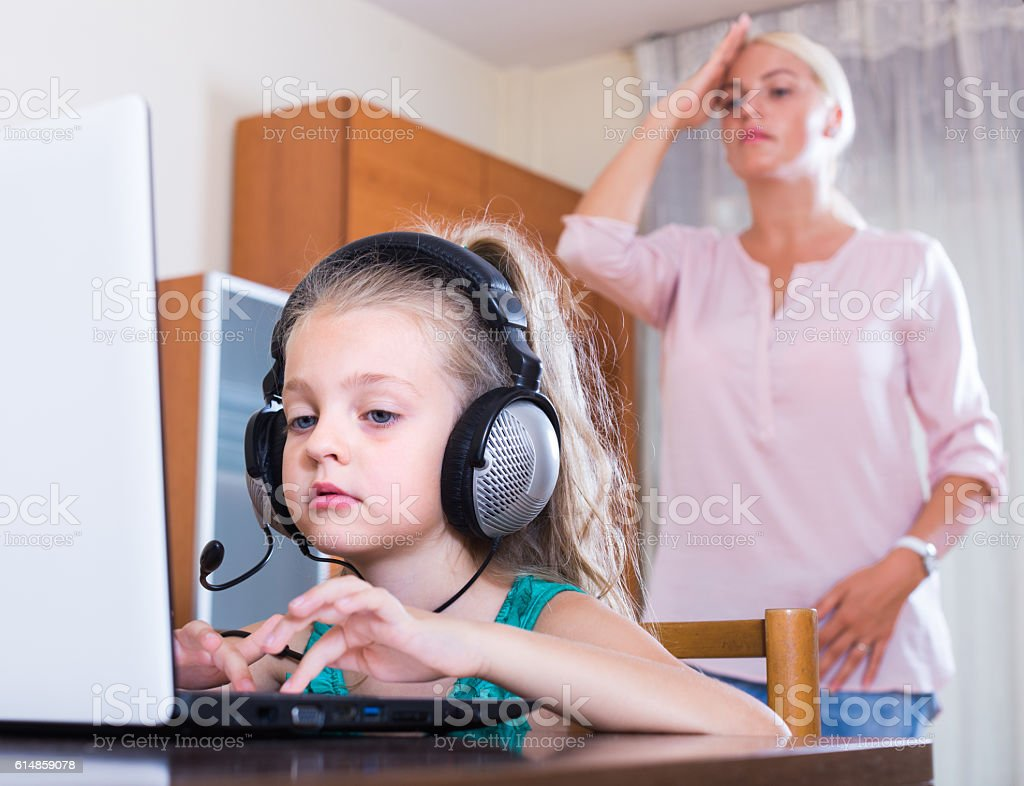 Little girl playing computer game stock photo