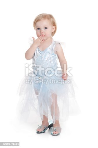 istock Little Girl Playing Dress Up with Hand Over Mouth 183807633