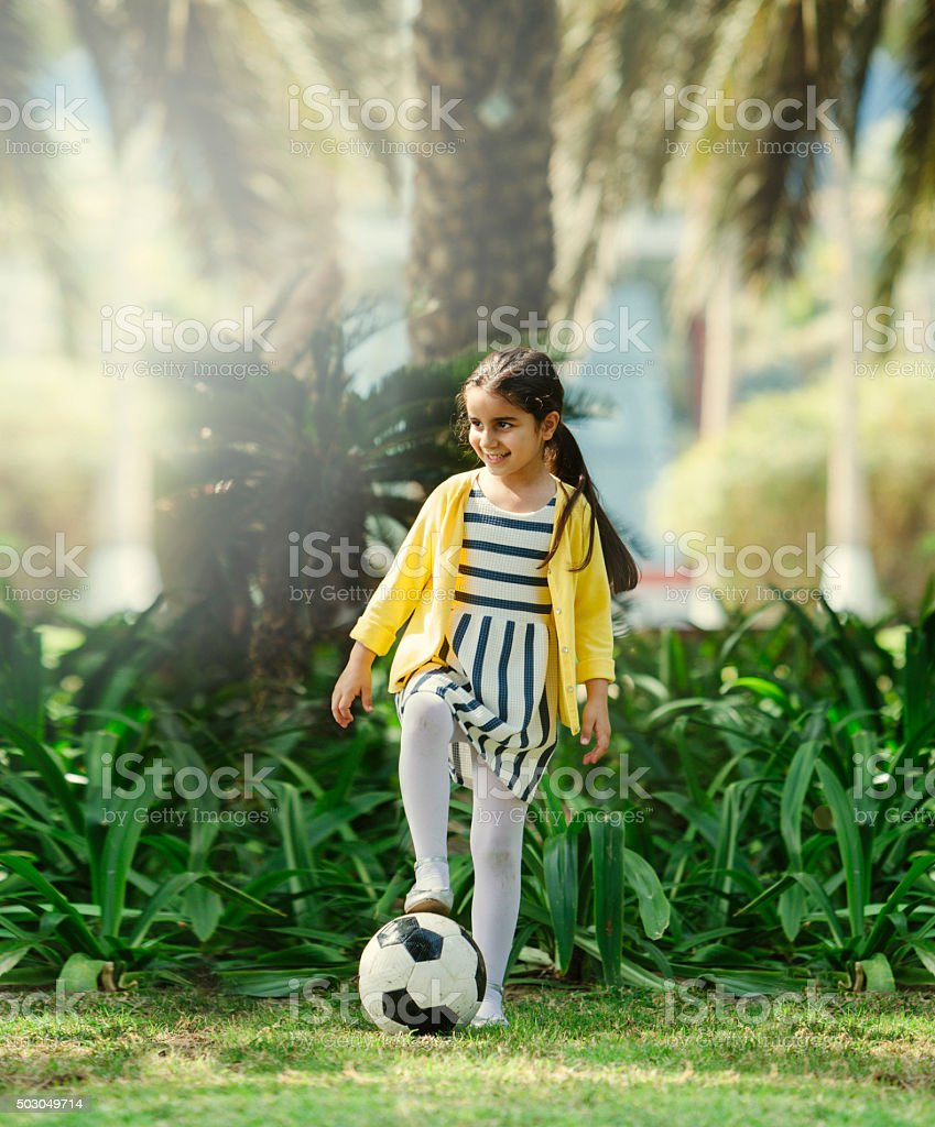 Little Girl Playing Football royalty-free stock photo