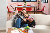 istock Little girl playing guitar and drum with her father 990659572