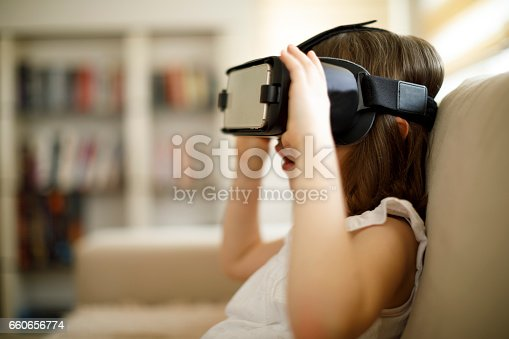 1019302738istockphoto Little girl playing imaginary game with virtual reality headset 660656774