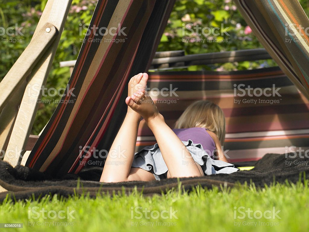 Little girl playing in a tent stock photo