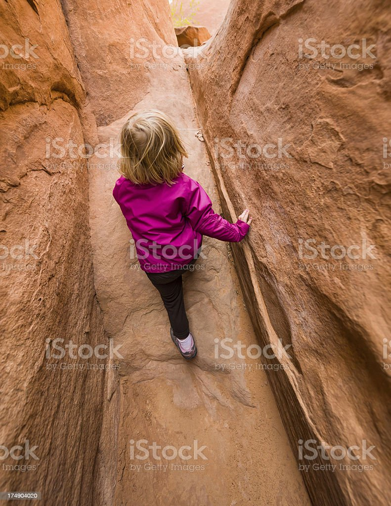 Little Girl Playing in Narrow Slot Canyon royalty-free stock photo