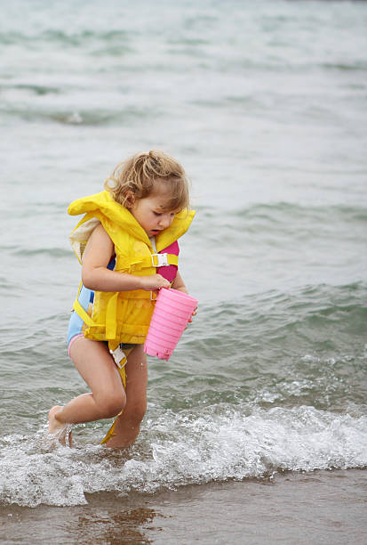 Little girl playing in water at beach