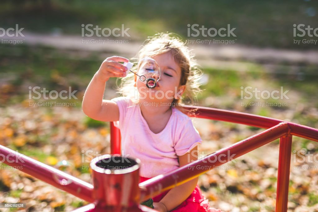 Little girl playing on autumn day royalty-free stock photo