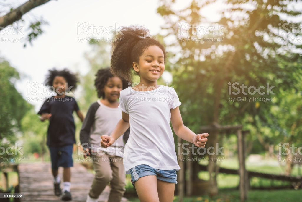 little girl playing outdoor stock photo