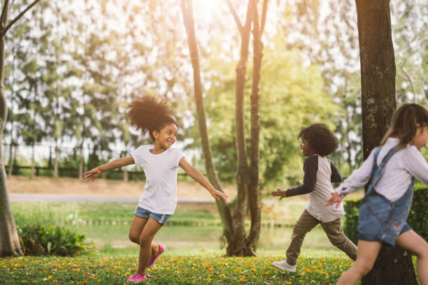 little girl playing outdoor - child stock photos and pictures