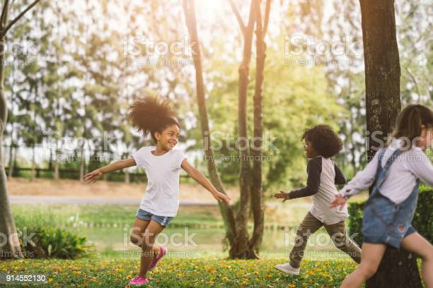 Cute african american little girl playing outdoor - Black people kid and friend happy.