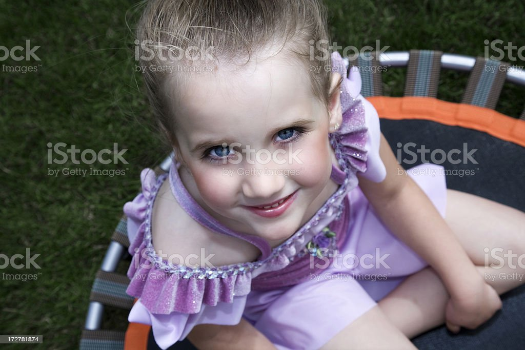 Little girl playing outside stock photo