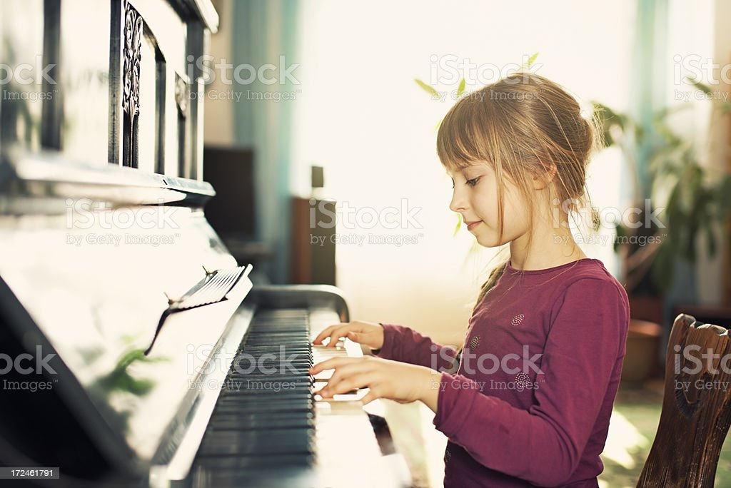 Little girl playing piano royalty-free stock photo