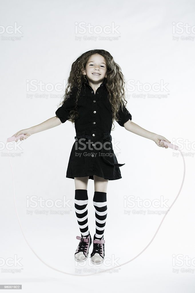 little girl playing skipping rope royalty-free stock photo