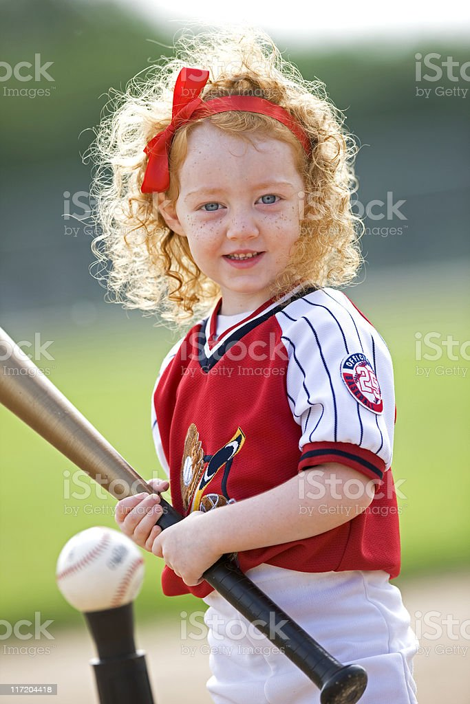 Little Girl Playing T-Ball stock photo