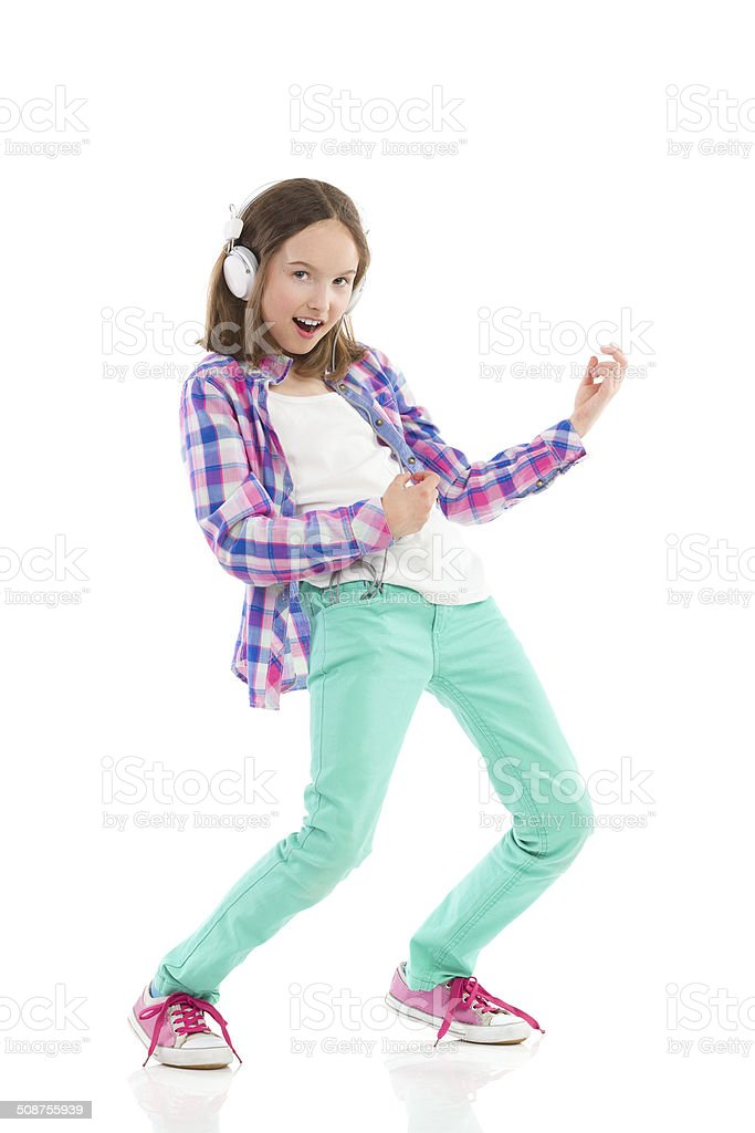 Little girl playing the air guitar stock photo