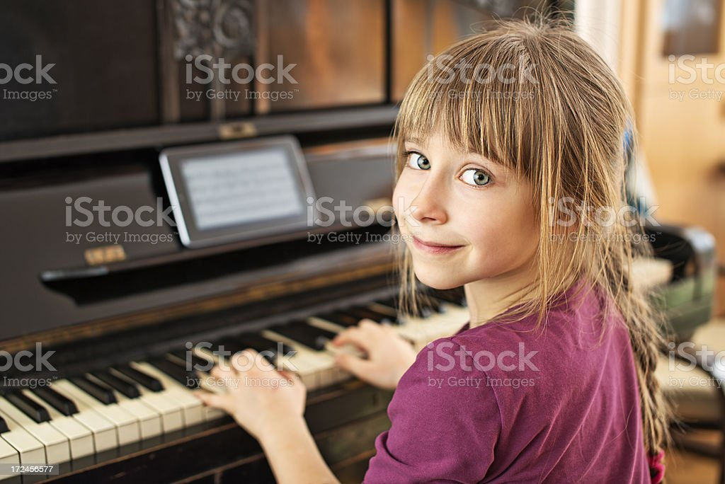 Little girl playing the piano royalty-free stock photo