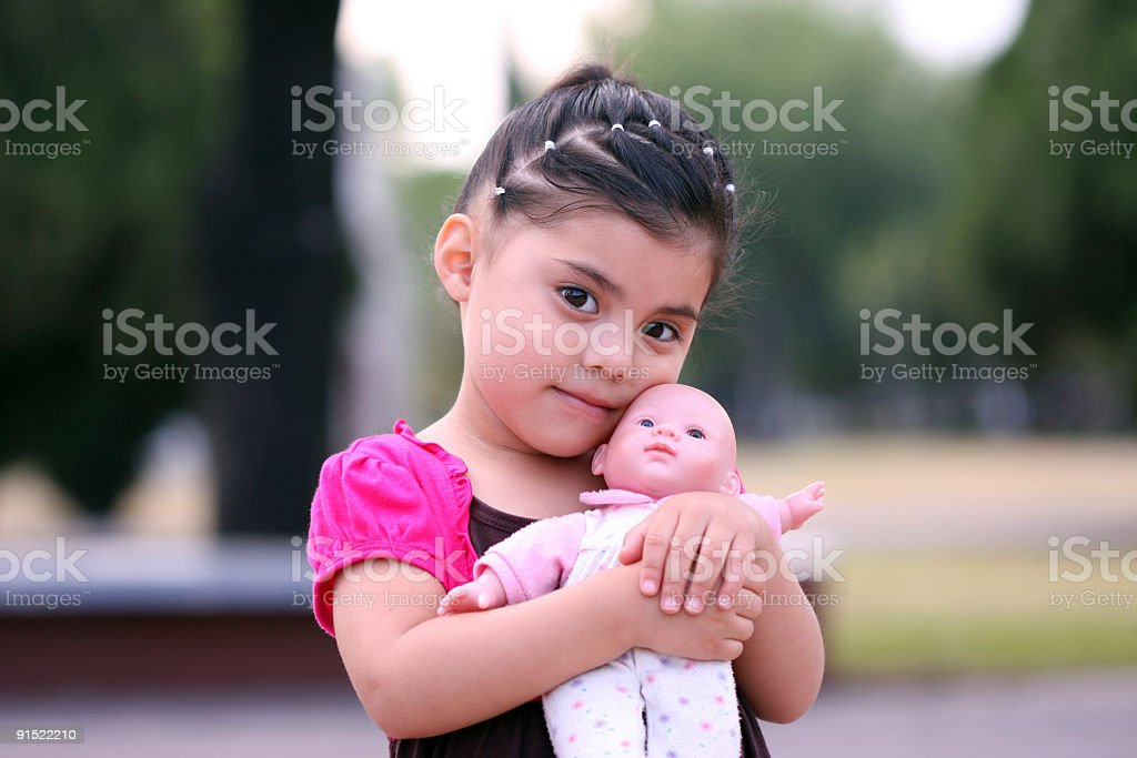 little girl playing to be mother royalty-free stock photo