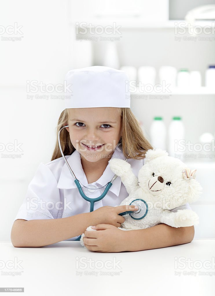Little girl playing veterinary royalty-free stock photo