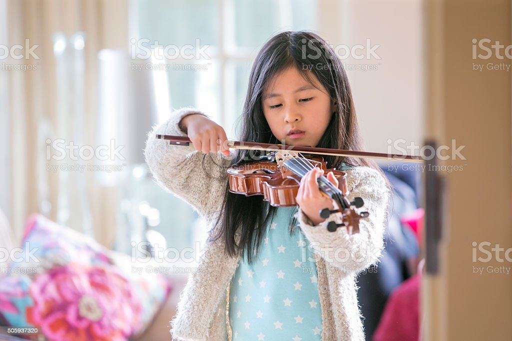 Little Girl Playing Violin stock photo