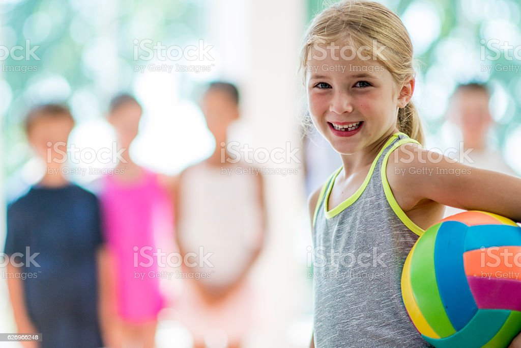 Little Girl Playing Volleyball stock photo